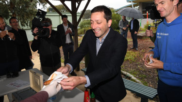Hold the onions: Matthew Guy has a democracy sausage on Saturday after voting earlier in the week.