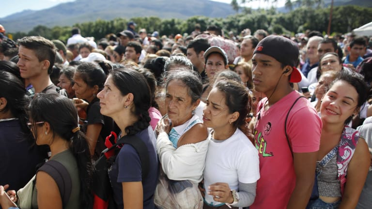 Venezuelans wait in line to enter Colombia via the Simon Bolivar Bridge in San Antonio del Tachira, Venezuela.