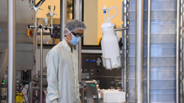 Scientists are seen at work inside of the CSL Biotech facility in Melbourne.