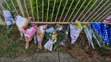 Flowers and cards are seen in front of the house where  42-year-old Katie Perinovic, and her three children - Claire, aged seven, Anna, five, and Matthew, three, were found dead in their Tullamarine home.
