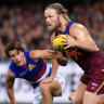 Zorko goes down as Lions hold off the Dogs