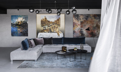 """Art takes precedence in the new home of Telstra CEO Andy Penn and his wife Kallie Blauhorn. Seen here are Chen Ping's """"Lonely Cloud Gordon River""""; Kate Bergin's """"The Venetian Room""""; Vicki Cullinan's """"Stars in the Night Sky""""."""