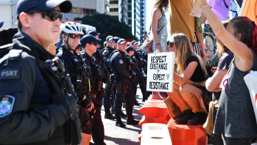 Police and protesters face-off in the Brisbane CBD.