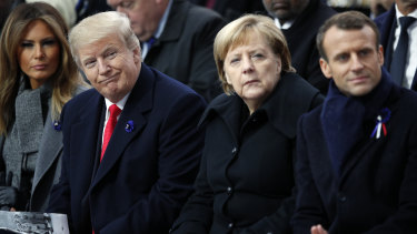 US President Donald Trump, German Chancellor Angela Merkel and French President Emmanuel Macron attend ceremonies at the Arc de Triomphe on Sunday.