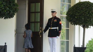 """""""Extraordinary courage"""": A Marine holds the door as Gianna Floyd, the daughter of George Floyd, walks into the White House."""