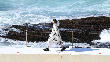 A model walks the runway wearing creations by Ten Pieces during Mercedes-Benz Fashion Week Australia.