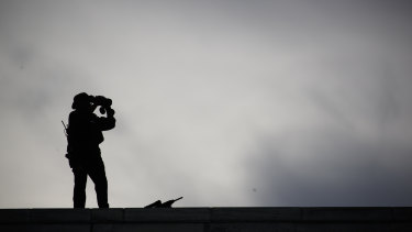 Security stands on the roof of the United Nations building during a visit by President Donald Trump.