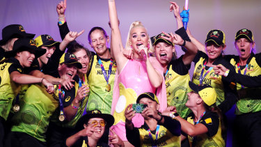 Katy Perry performs on stage with the Australian cricket team following their victory in the ICC Women's T20 cricket world cup final match against India.