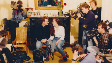 Jacqueline and Iain Gillespie face a ring of television cameras.