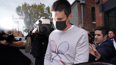 Richard Pusey is led from his home by police in Melbourne in April.
