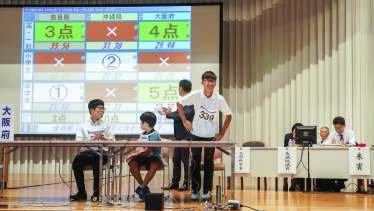 A member of a team from Osaka takes a bow after scoring 5 points at the abacus championships in Kyoto