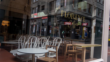 A Melbourne cafe closed due to the coronavirus outbreak. Women account for two-thirds of the staff in the heavily affected retail, hospitality and healthcare sectors.