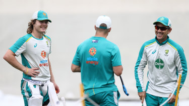 Pucovski and coach Justin Langer (right) train at the SCG on Wednesday.