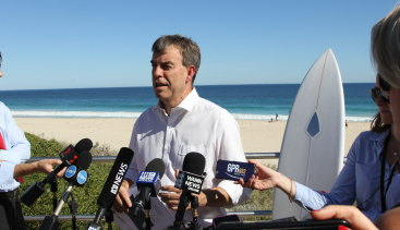 Fisheries Minster Dave Kelly wants the NSW government to release the final report of research into shark deterrent devices.