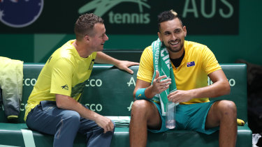 Old acquaintances: Team captain Lleyton Hewitt has a lighter moment with Kyrgios during his singles win.