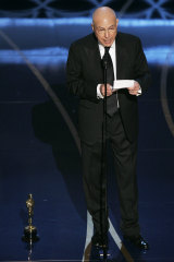 Actor Alan Arkin accepts the Oscar for best supporting actor.