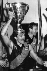 Tiger Dale Weightman with the premiership cup after Richmond's win.