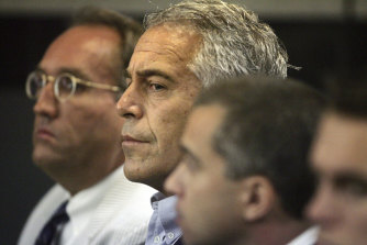 Jeffrey Epstein, centre, in court in 2008.