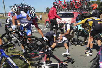 Nicolas Roche, centre, is treated by medics after falling during the tenth stage of the Tour de France.
