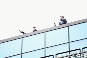 Armed police officers are seen on the roof of Christchurch High Court prior to the sentencing hearing of Brenton Tarrant.