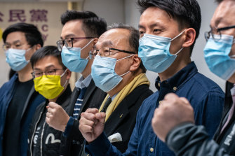 Pro-democracy activists gesture during a press conference on January 6 in Hong Kong after 50 opposition figures were arrested under the national security law.