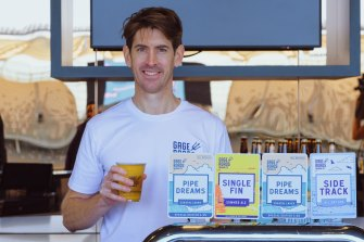 Gage Roads head brewer Ross Brown with the craft brewery's range of beers on tap at Optus Stadium this year.