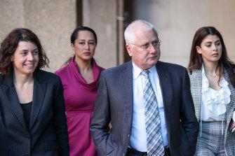 Bret Walker, SC, centre, arrives at the Federal Court on Friday.