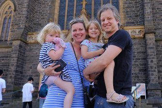 Frida and Markus Barth, with children Josefine, 2, and Carla, 5, outside St Patrick's Cathedral.