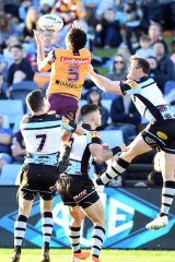 Xavier Coates provides a rare moment of brilliance in a sloppy game with this leap for a Broncos try.