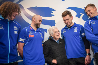 The Kangaroos return the support of longtime fan Dorothy Forth, who was the victim of a home invasion.  Ben Brown, coach Rhyce Shaw, Shaun Higgins and Jack Ziebell were at the presentation.