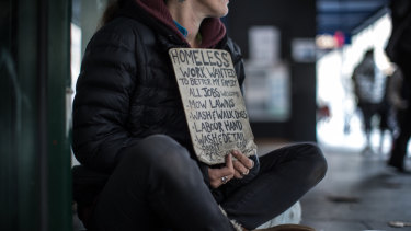 'I'm busting to get back to work': homeless woman Rachel, 37, appeals for work in Elizabeth Street, Melbourne.