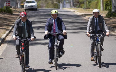 Danish ambassador Tom Norring, left, Estonian ambassador Andres Unga, centre, and Norwegian ambassador Paul Larsen riding through Yarralumla.