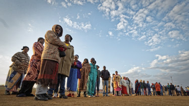 South Africans queue in the early morning cold to cast their votes in the mining settlement of Bekkersdal, west of Johannesburg, on Wednesday.
