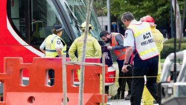 Emergency services at the scene of a collision between a tram and a pedestrian in Canberra on Saturday morning.