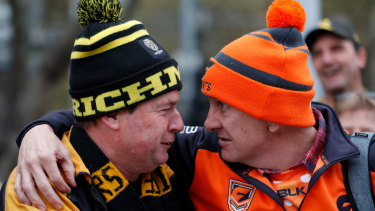 Richmond and GWS fans prepare for the grand final parade on Friday, and the bigger battle to come.