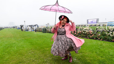 Hayley Toms plays it safe and stylish in gumboots at Flemington on Melbourne Cup Day 2018.