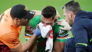In doubt: Nick Cotric comes off injured after accidentally copping a boot to the face.