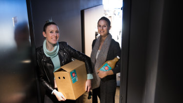 Lauren Davie  and Elena Andoniou delivering their hot apple cider to cafe Monroe in Richmond.