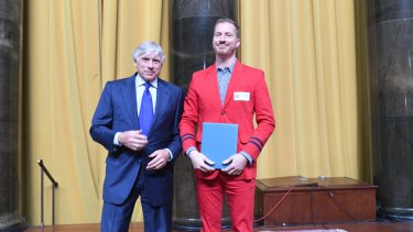 With the president of Columbia University, Lee Bollinger, after receiving the Pulitzer Prize for Fiction.