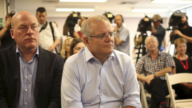 Prime Minister Scott Morrison (centre) with North Sydney MP Trent Zimmerman  at an announcement in Sydney on Sunday.