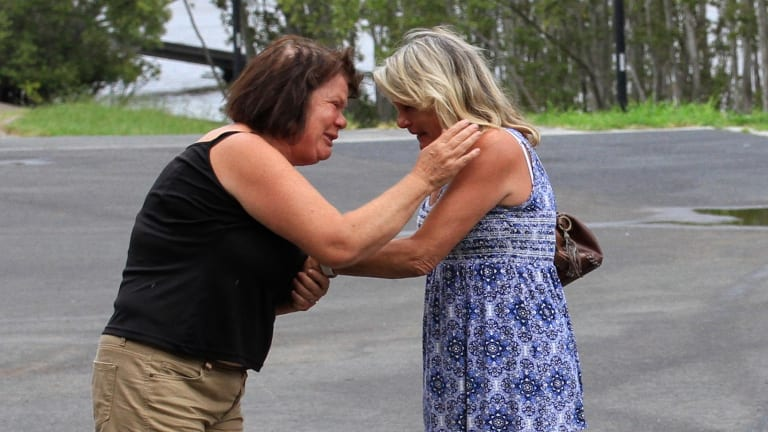 Sandra Roome (left) and Christine Landy comfort each other as they wait for news.