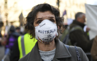 A climate change protester outside Australia's embassy in London early this year as the bushfires raged and the coronavirus crisis was just beginning to unfold.