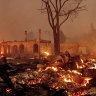 Fire engulfs California town, destroying shops and homes