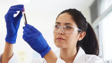 A lab technician prepares a shot.