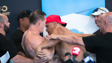 Fisticuffs: Paul Gallen and John Hopoate had to be separated as tensions bubbled over at Thursday's weigh-in.