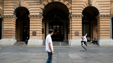 Skateboarders take advantage of a quiet Martin Place in Sydney's CBD during lunchtime.