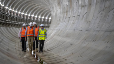 Premier Gladys Berejiklian inspects the first of two metro railway tunnels deep under Sydney Harbour.
