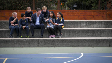 Principal Rob Duncan with a group of Year Five students whose results have markedly improved.