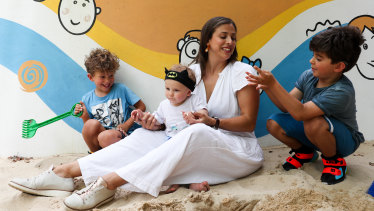 The Reis Souza family have three children who were born with hearing loss. From left, Gabriel, 5, Luca, 10 months, mother Renata and Rafael, 7.