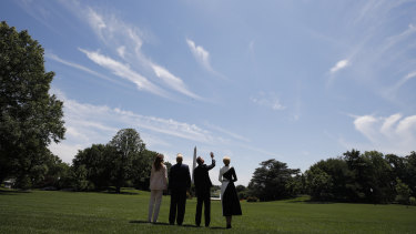 The first couples of the United States and Poland watch a flyover of one of two F-35 Joint Strike Fighter aircraft at the White House.